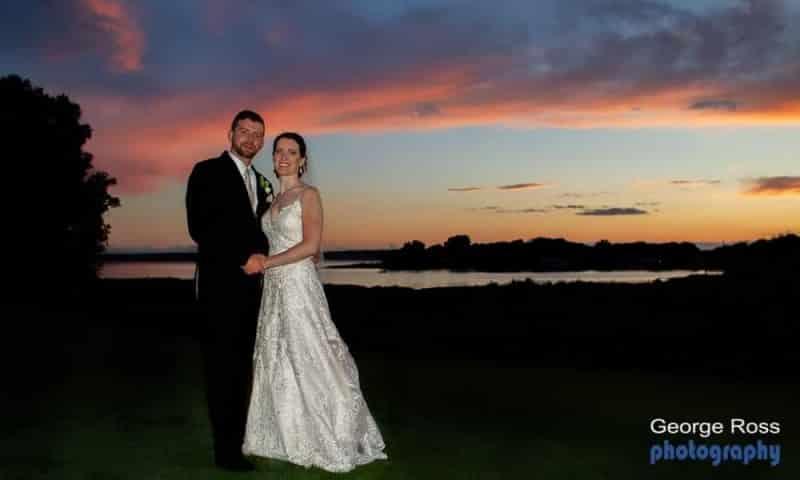 Bride and groom at sunset at harbor lights, RI