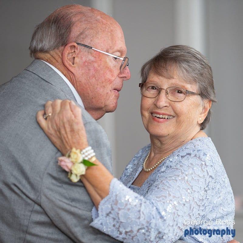 Elderly couple dance at wedding