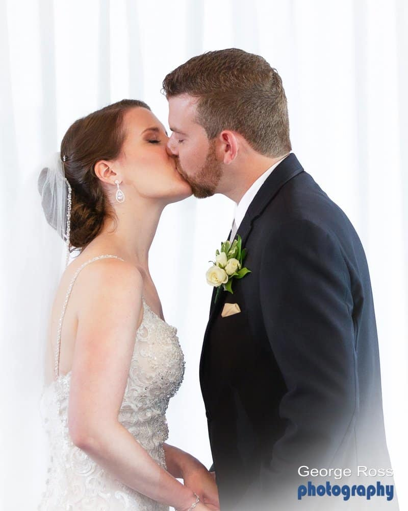 wedding ceremony, the groom kisses the bride