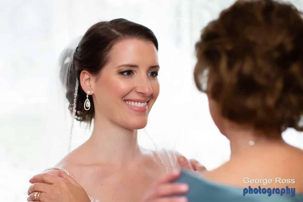 bride looking in her mother eyes before the wedding