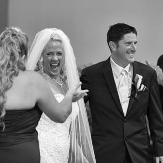 A bride screams with joy after being pronounced married inside a church