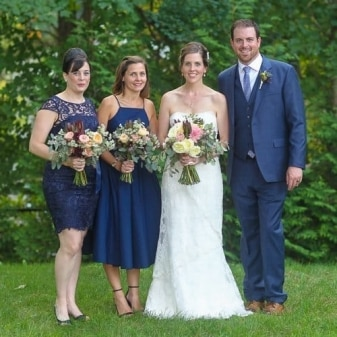 bride and groom photographed with the bride's sisters