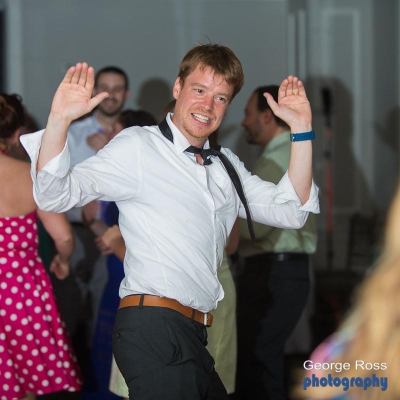 young man dancing at wedding reception