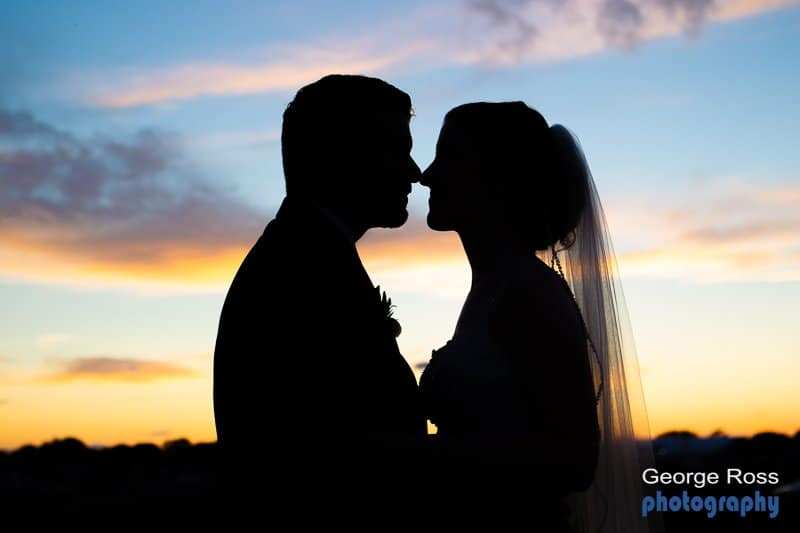 Bride and groom at sunset, Harbor lights, Warwick