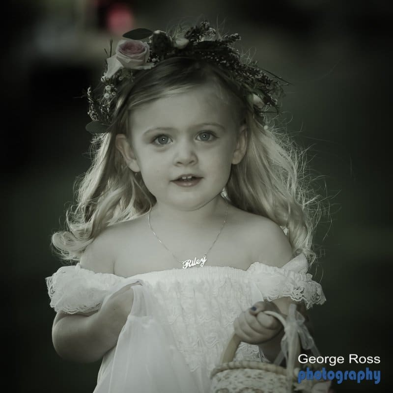 a young female ring bearer at a wedding