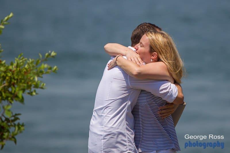 a couple hug after a wedding proposal