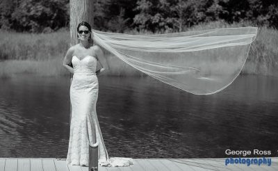 Bride with her veil blowing in the wind