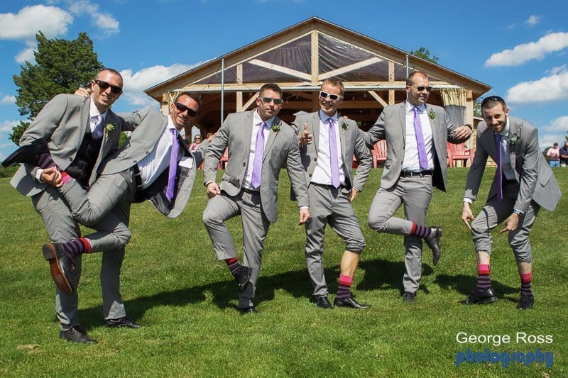 Groomsmen showing off socks Harbor Lights Wedding