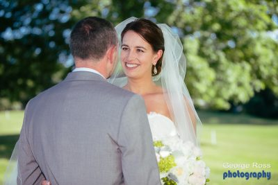 Close up of a bride looking at her groom