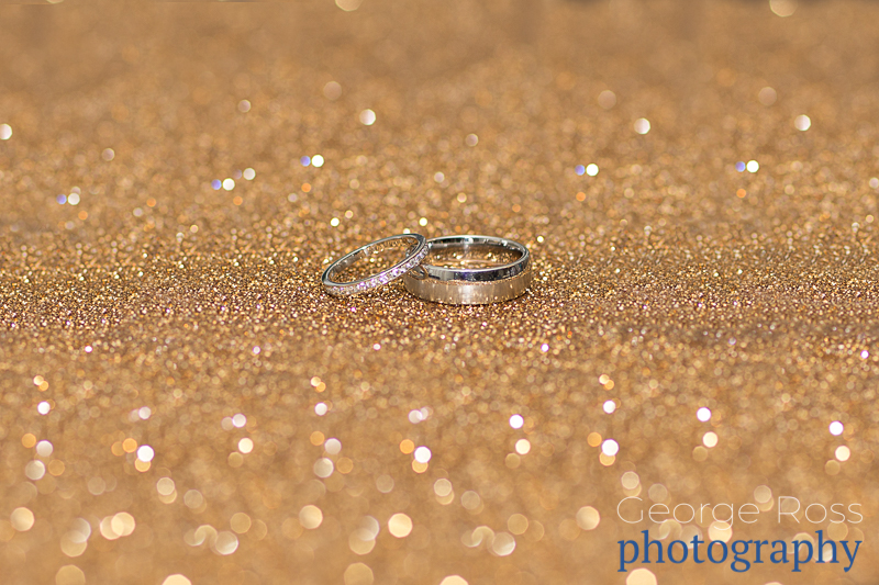 Wedding ring on a gold back drop