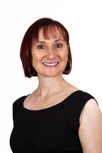 Female management on a high-key white back for business headshot