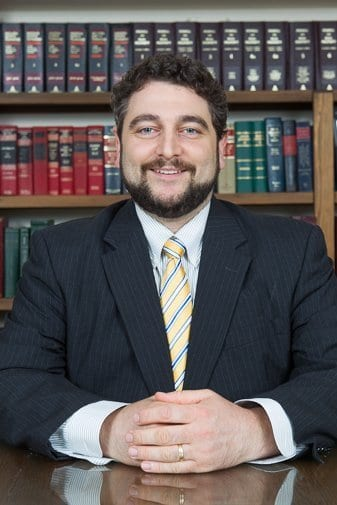 An attorney headshot while sitting at his desk
