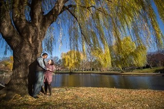 A newly engaged couple in Boston Common in the fall