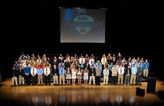 a large group of student athletes on stage at an awards ceremony in Providence, Rhode Island