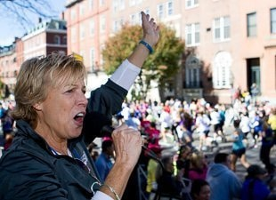 a race announcer cheering on the runners