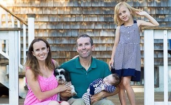 Mom, dad, daughter, new born baby and Pancakes the dog