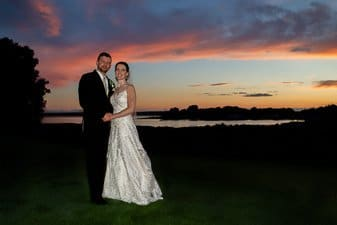 Bride and groom at sunset at Harbor lights, Warwick
