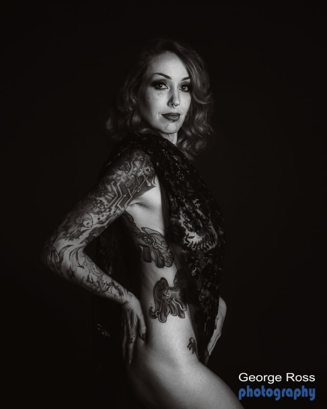 naked tattooed female model, implied nudity