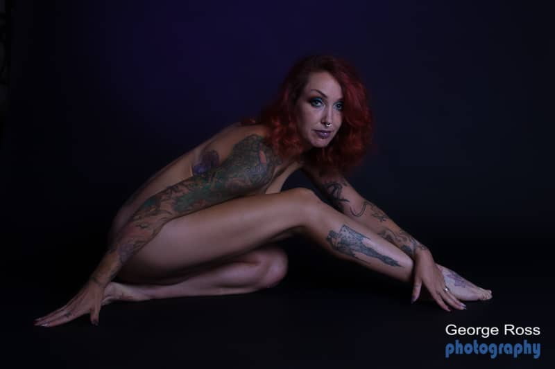 nude tattooed model with septum