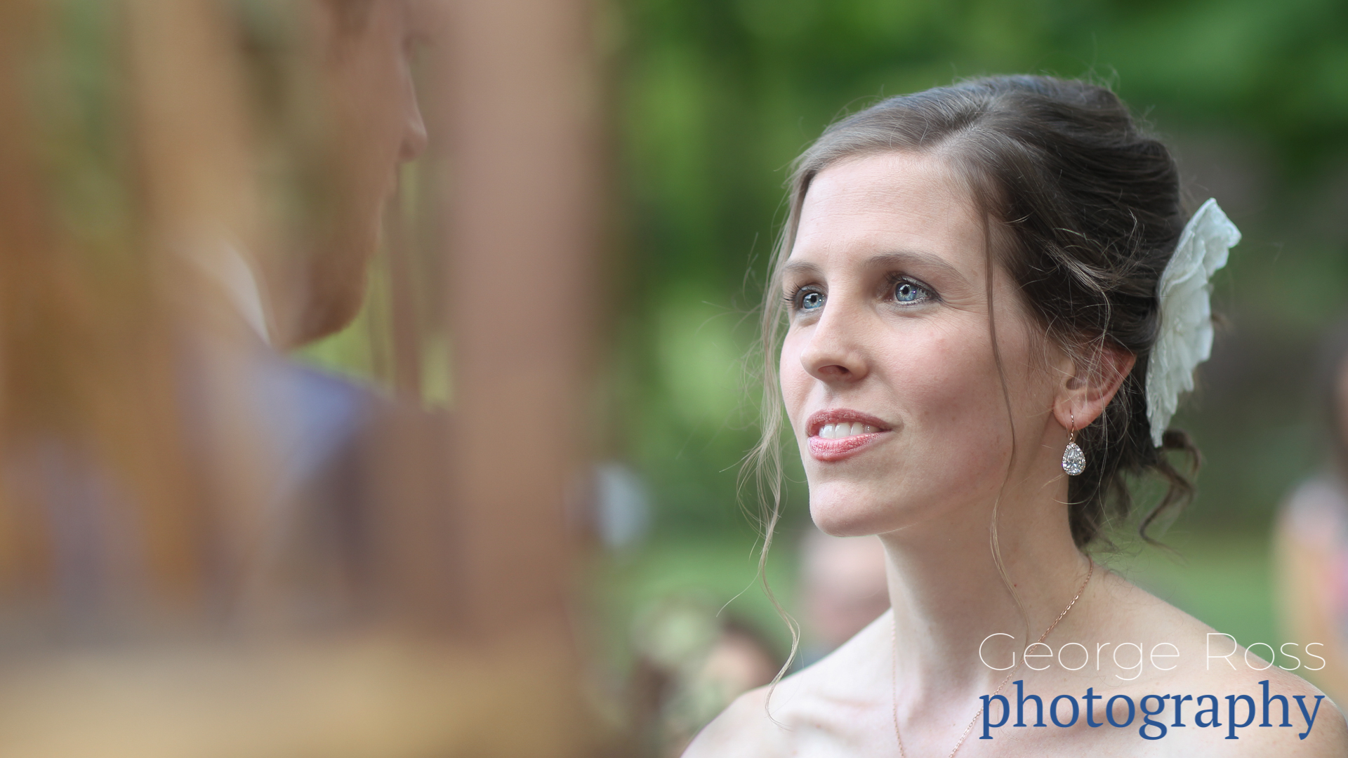 close up of bride staring intensly at her groom during the ceremony