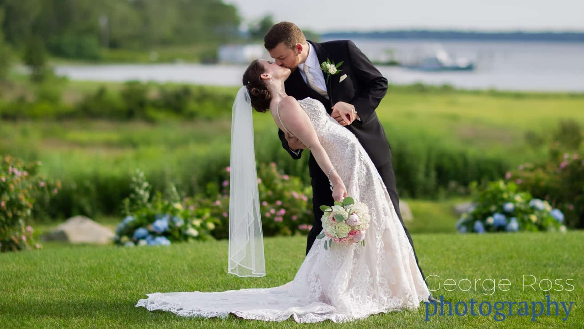 a groom dipping his new wife during the wedding portrait shoot shortly after the wedding ceremony by Rhode Island Wedding Photographer George Ross