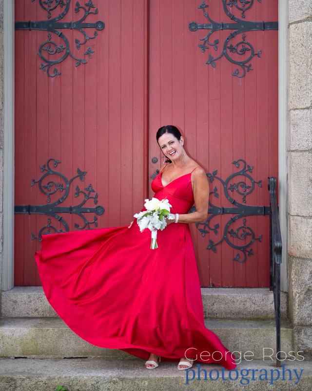 bridesmaid swinging her red dress in front of church door