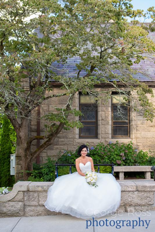 bride sitting under a treee in east greenwich, rhode island