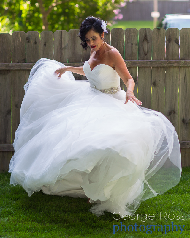bride having fun with her wedding dress