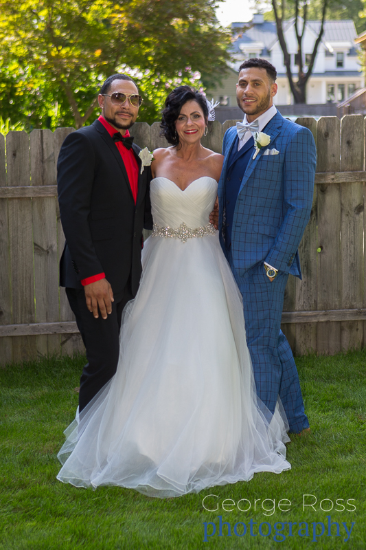 bride posing with her sons