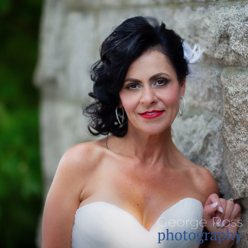 beautiful photo of bride leading against a wall with lots of romantic blur