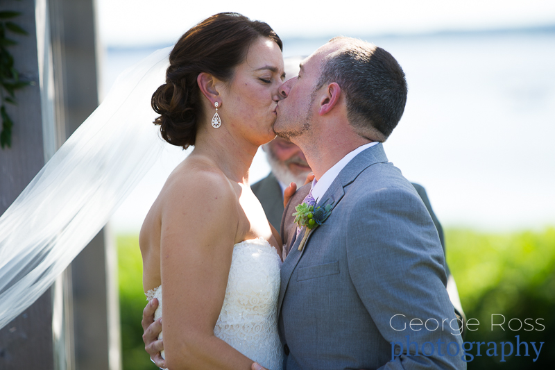 bride kissing the groom after being pronounced man and wife