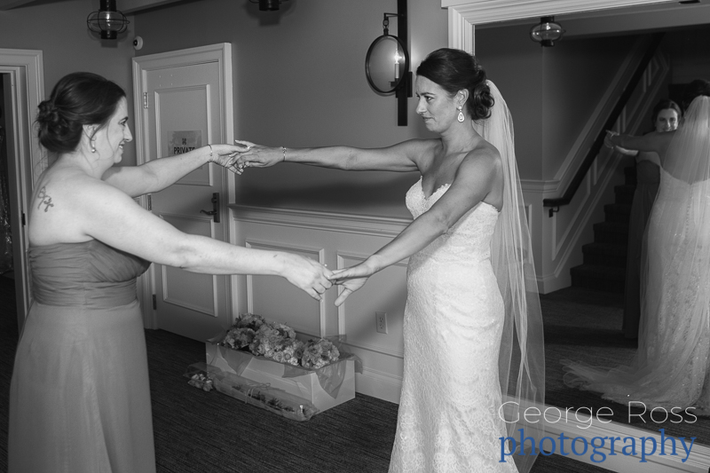 bride and sister hold hands