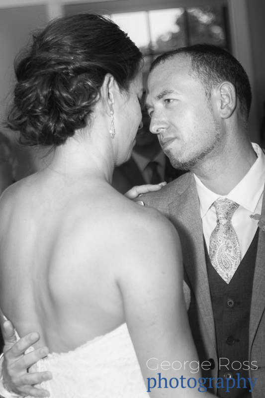 groom looks at his new wife during their first dance