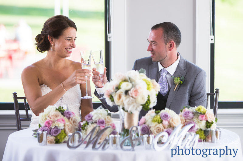bride and groom at the sweetheart table