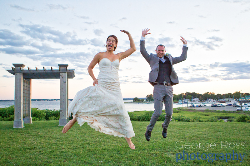 bride and groom jump in the air
