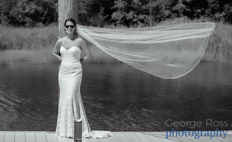 bride with hew veil flying in the breeze