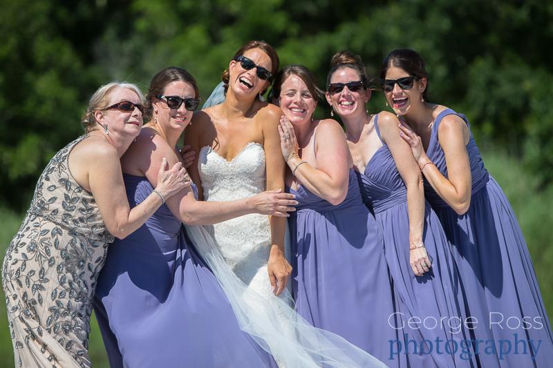 bride and her bridesmaids having fun