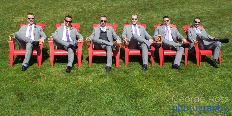 groomsmen sitting in adirondack chairs