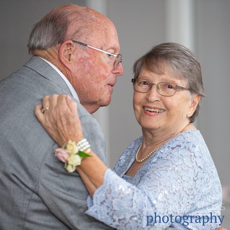 elderly couple dancing at wedding reception