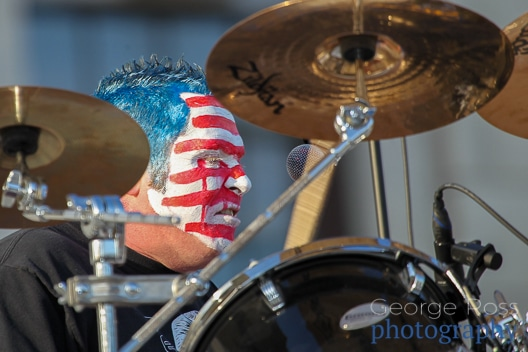 close up of a drummer with a painted face