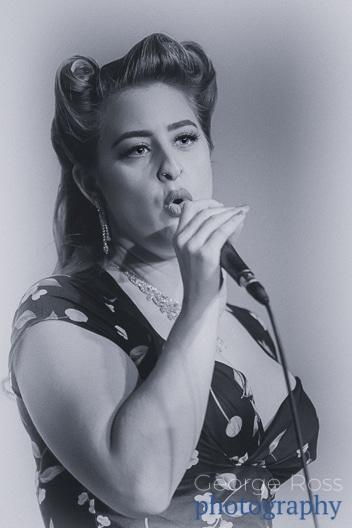 vintage style female singer in polka dot dress