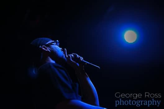 performer under a blue spotlight
