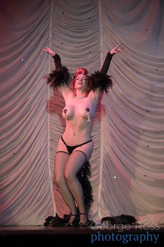Blaze: burlesque performer revealing her breasts