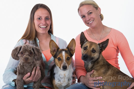 two ladies with three dogs