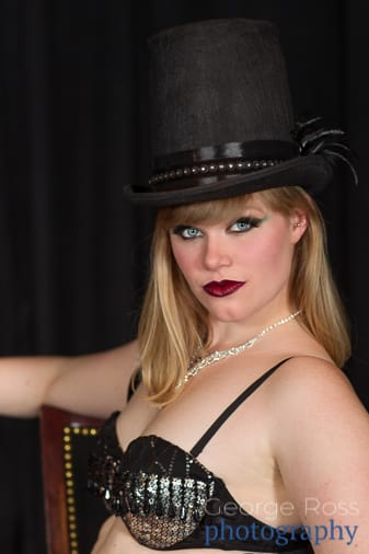 blonde woman wearing a top hat