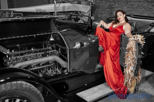 woman with long red dress in a vintage car