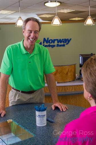 bank customer talking to member of staff