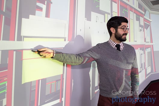 man posing at a power point presentation