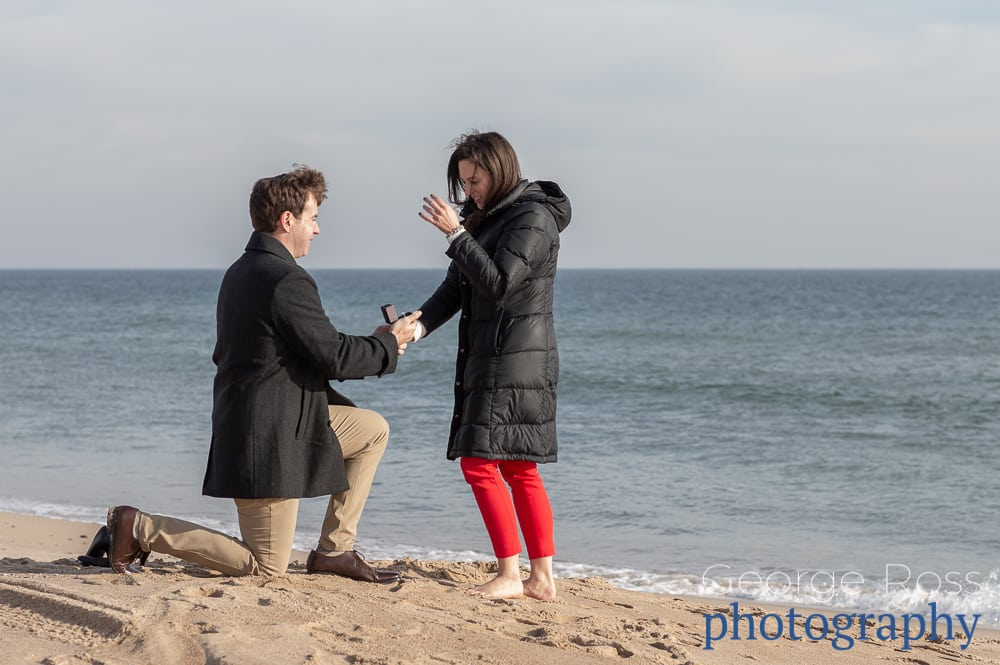 man on his knees proposing outside the ocean house in westerly, rhode island