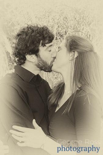 a couple kiss after a proposal in narragansett, rhode island